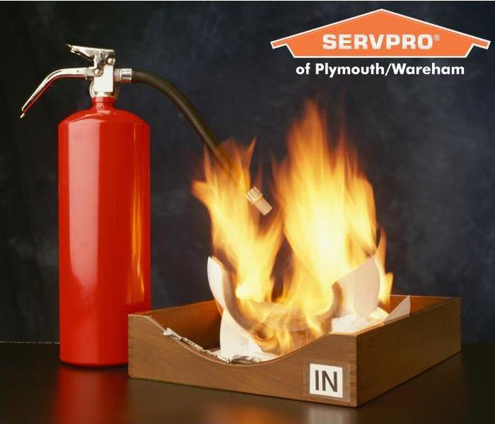 "image of a fire in an office supply ""in"" bin, symbolic of fires in the workplace"